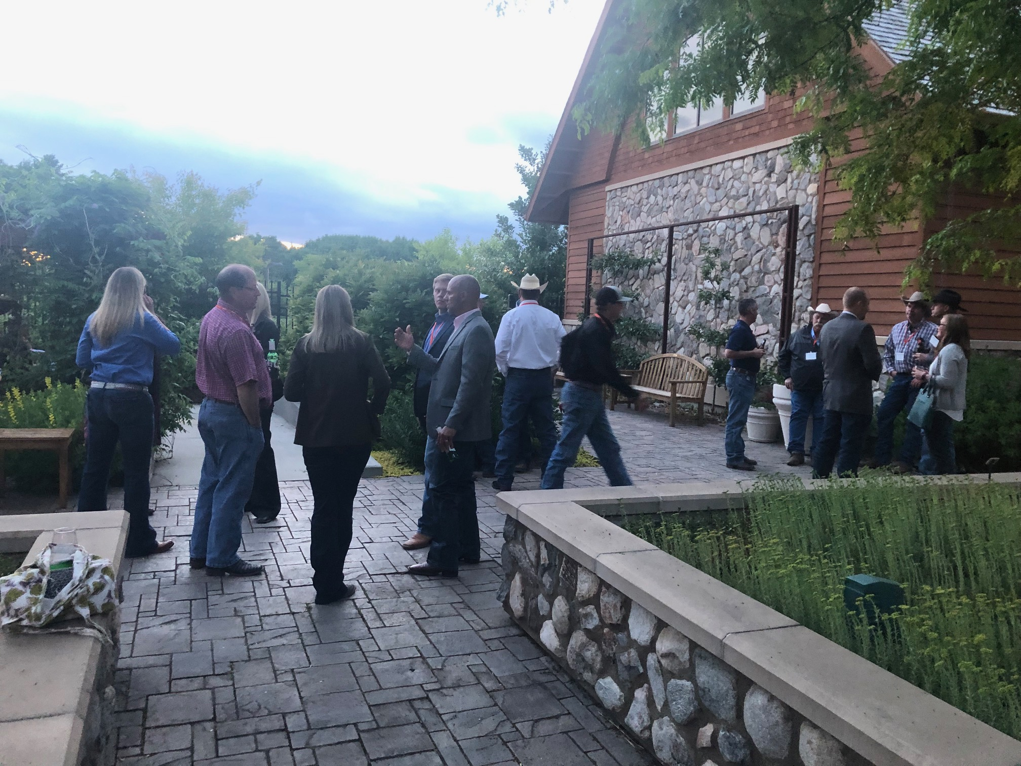 IGS breed association staff_ academics_ allied industry personnel_ and seedstock breeders mingle at the IGS social.