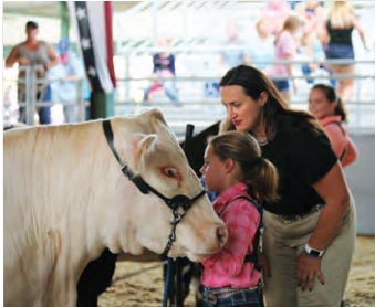 Rincker asking questions during a livestock show.